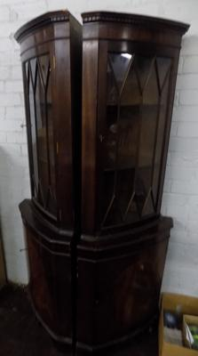 Two dark wood corner display units with keys