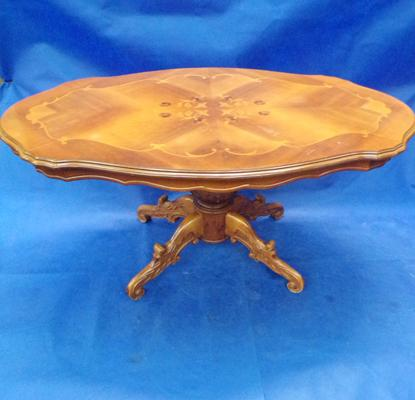 Oval shaped coffee table with inlays.