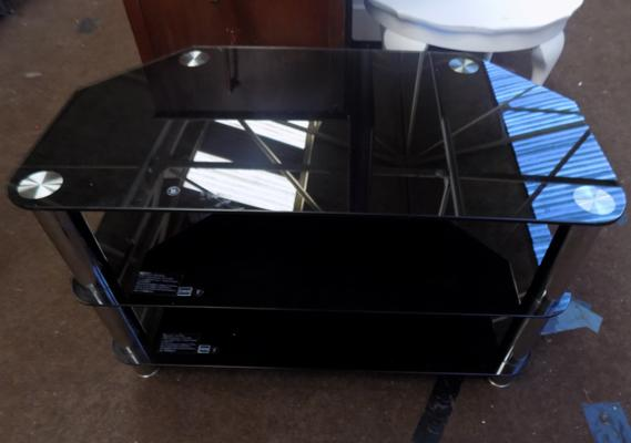 "Black glass with chrome legs unit. Size 3"" x 16"" x 19"""