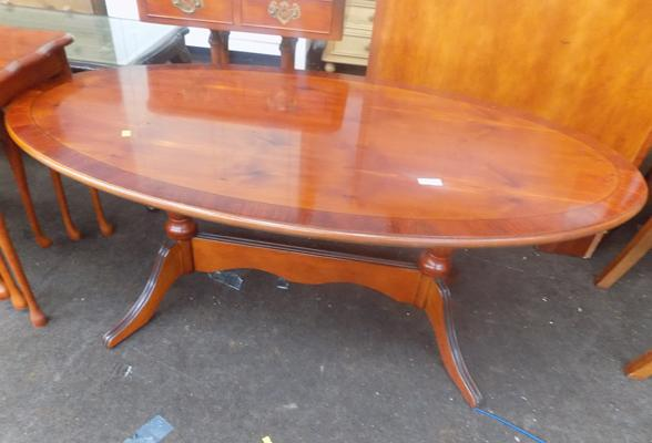 Polished walnut veneer oval coffee table