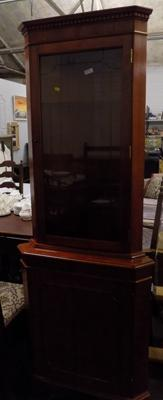 Polished walnut veneer corner cabinet