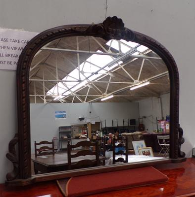 Over mantle ornate framed mirror