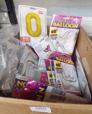 Box of metallic helium balloons