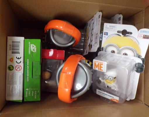 Small box of new toys including minions