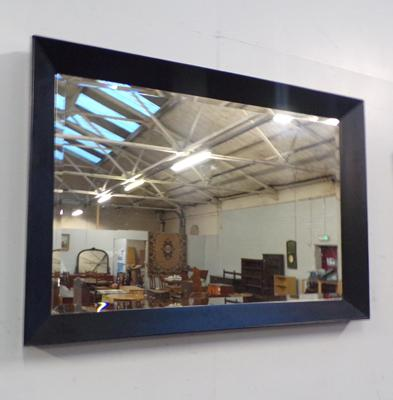 Bevelled edge black framed mirror