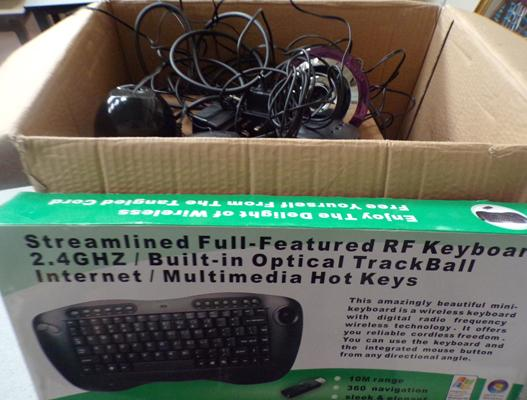 Box of new computer keyboards & others