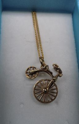 Silver penny farthing on chain