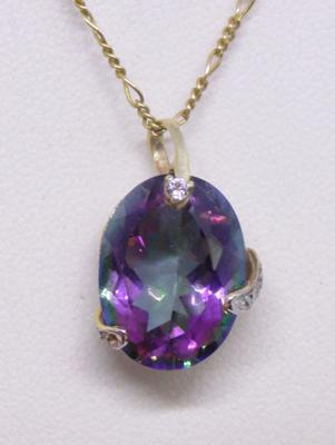 9ct gold Figaro chain and 9ct gold diamond and mystic topaz pendant on 20 inch chain