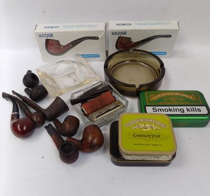 Selection of pipes, tobacco tins etc.