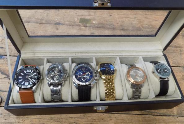 Six watches with display case