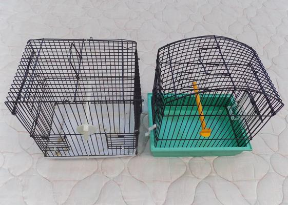 2 small bird cages