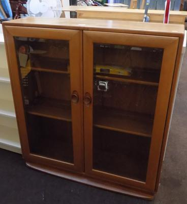 Ercol glass fronted cabinet/bookcase