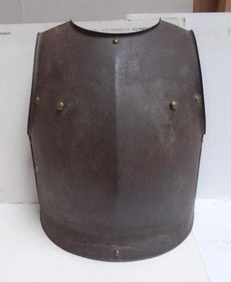 French Cuirassiers breastplate, early 19th Century, of one piece construction with medial ridge & brass stud fittings, edges turned out & outward-flanged lower edge, 8 internal hooks at edges, interna