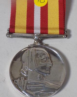 A WWII silver red cross medal