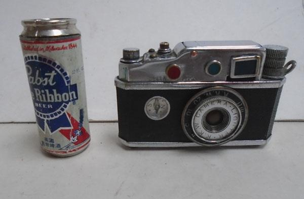2x Collectable lighters in the form of a camera & beer can