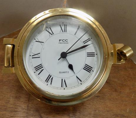 1 brass ship's clock - W/O
