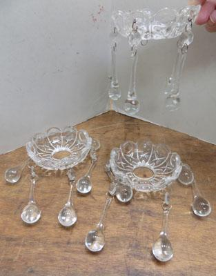 Three glass candle sconces