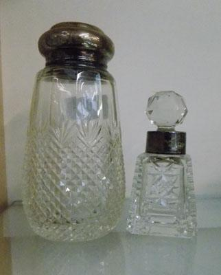 2 silver topped cut glass decanters