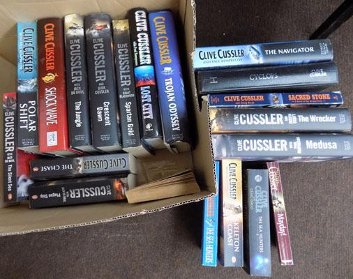 Box of Clive Cussler novels