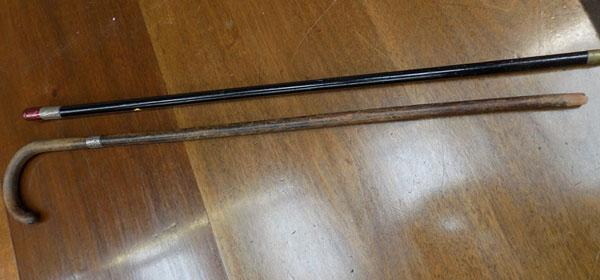 Birmingham silver walking stick & 1 white metal walking stick