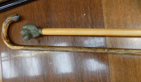 2 x walking sticks, incl. ornate dogshead