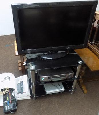 Panasonic TV and stand + DVD player & VHS player