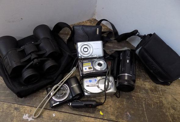 Box of cameras, handhold recorder & binolulars
