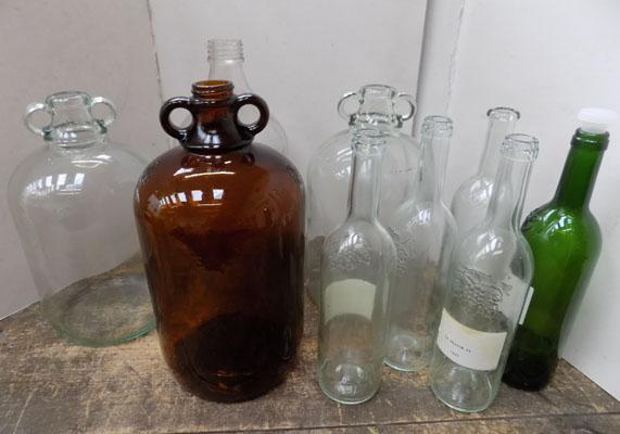 Demijohns and wine bottles