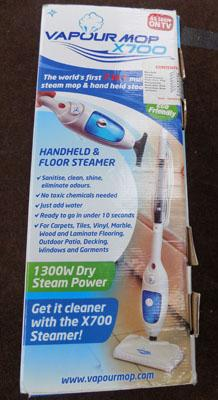 Hand held floor steamer