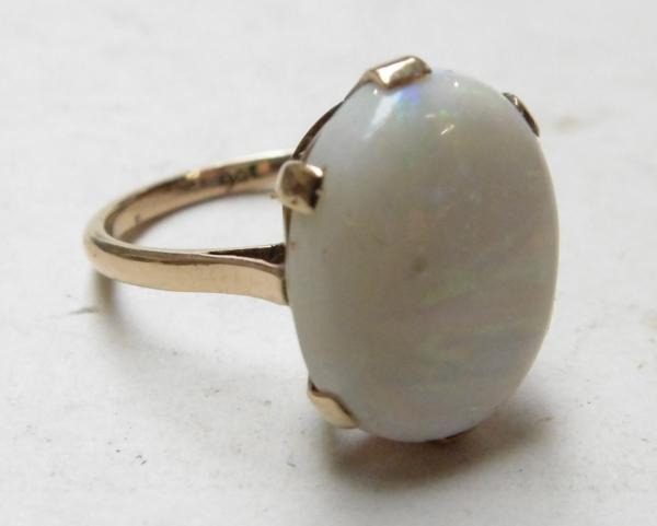 9ct Rose gold over 6 carat & large opal ring