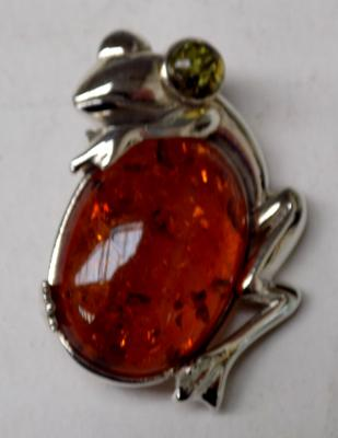 Silver and amber frog brooch