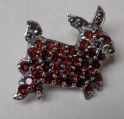 Silver and garnet rabbit brooch