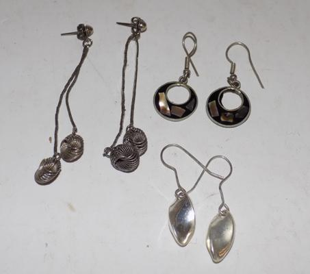 Three pairs of silver earrings