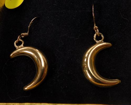 Pair of gold on silver moon earrings