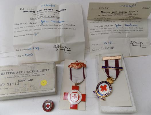 2 British red cross medals and 1 badge