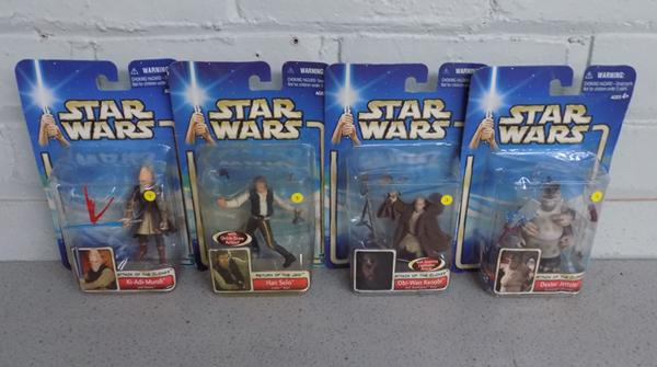 Four sealed/carded Star Wars figures