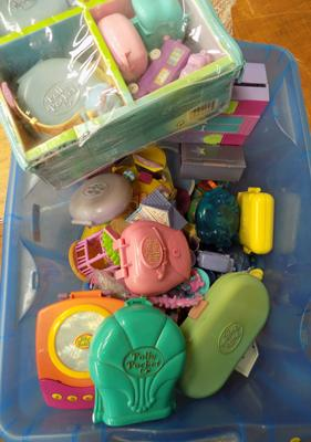 Box of Polly Pocket compacts