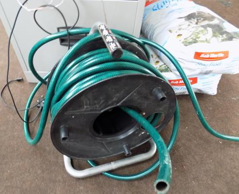 Green garden hose on reel