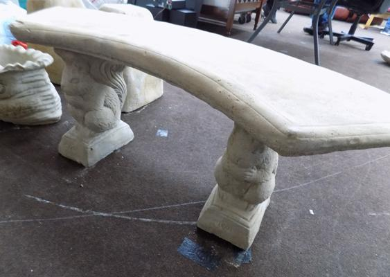 "Carved stone squirrel garden seat on plinths, 17"" high  x  42"" wide"