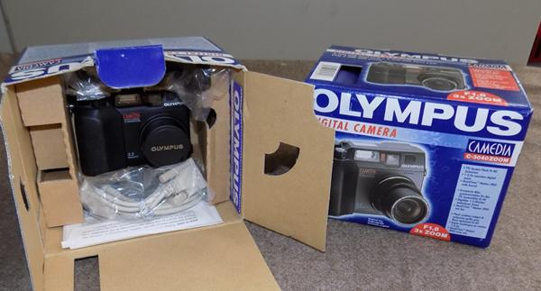 2 Olympus digital cameras (boxed)