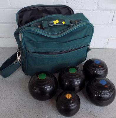 Bag containing four bowls and a jack