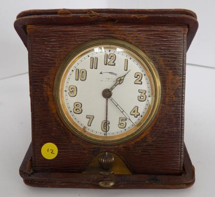 Antique travel clock in leather case