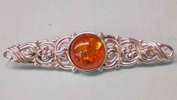 Silver and amber celtic brooch