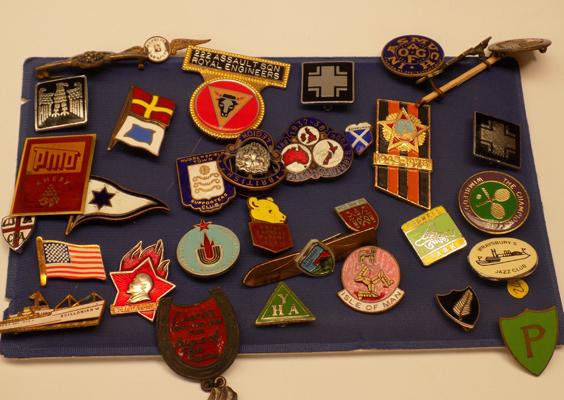 Selection of enamel badges - all different topics and countries