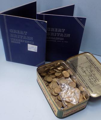 Over 120 brass threepence coins with 2 Whitmans coin folders