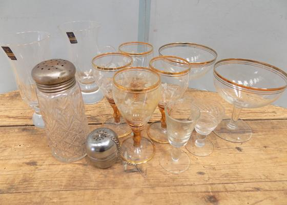 Selection of vintage items including tea strainer.