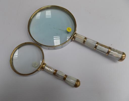 Two mother of pearl, rimmed magnifying glasses