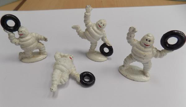 Four small Michelin men with tyres