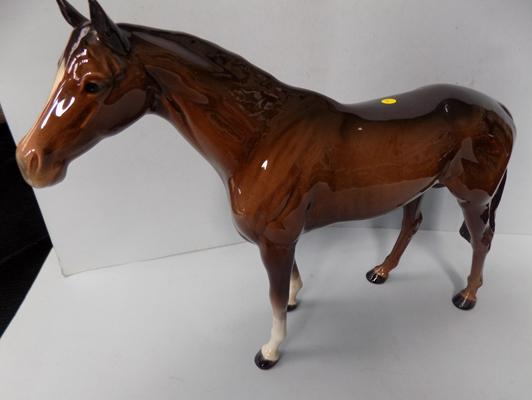 "Beswick racehorse, Connoisseur series, model No. 1564, 11 1/4"" high. Small chip on one ear."