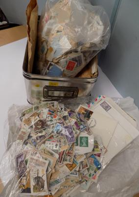 Tin box of stamps in bags, over 1kg - envelopes, first day covers, GB stamps loose